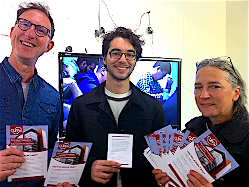 Gabriel Bushell (centre), student in Film Studies, shows his signed card of support for Part-time faculty to have the right to undertake and be paid for administrative and supervisory work, in addition to their teaching duties. Part-time professors Philip Szporer and Mary Ellen Davis stand alongside him at the launch of CUPFA's campaign during Campus Equity Week on October 27th, 2016.